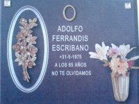 flores y jarron bronce letras grabadas